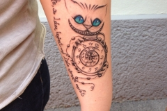 angelika-gross-tattoo-Grinsekatze